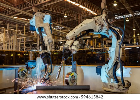 Robots are welding in factory