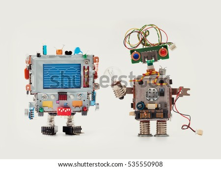Robots in love. Funny man mechanism with monitor head, love heart abstract message on blue screen Woman robot green circuit face, electrical wire hairstyle, color blue red eyes, light bulb in hand.