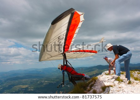 ROC, CROATIA - JUNE 29: Competitor  of the Croatian Open hang gliding competitions takes part on June 29, 2011 in Roc,  Croatia