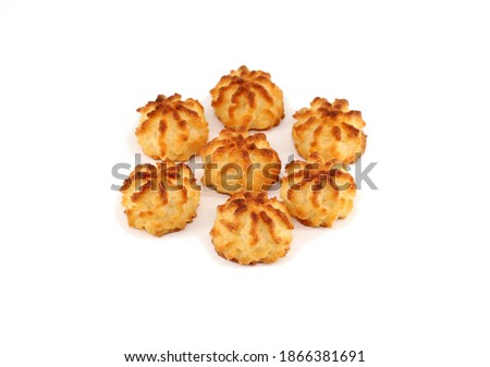 Rocher au coco, coconut rocks in english, on white background. They are small cake with grated coconut of belgian and french tradition. They are known also as Congolais. Photo stock ©