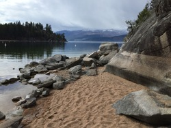 Rock and sand beach Okanagan Lake, British Columbia