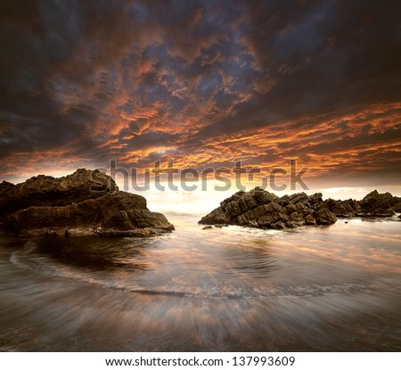 Rock and sea with sunset