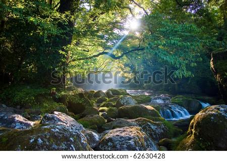 Rock and shaft beam of light - stock photo