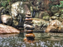 Rock Balancing Art  Beautiful Rock design on river. Natural Background.