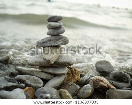 Rock balancing or stone balancing. #1106897033