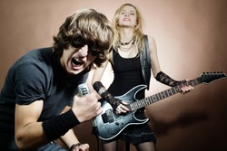 Rock band:  man and woman during concert.