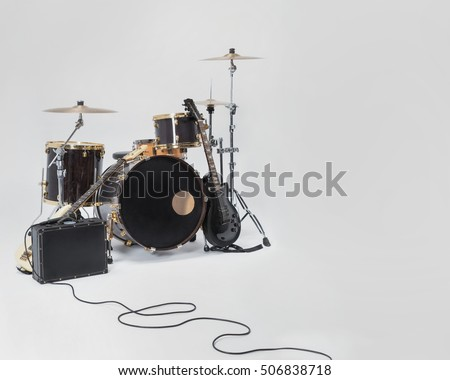 Rock Band, solo guitar, bass, drums, microphone on a black suitcase. Music instruments