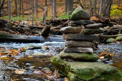 Rock Cairn by a creek in early fall