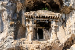 Rock carved ancient Lycian tombs in Pinara, Turkey.