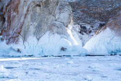 Rock cliff with ice stalactite in Lake Baikal, Russia, landscape photography