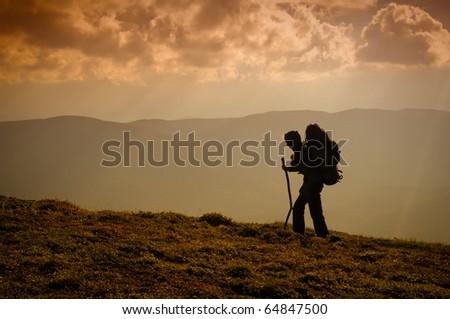 Rock climber ascending the mountain