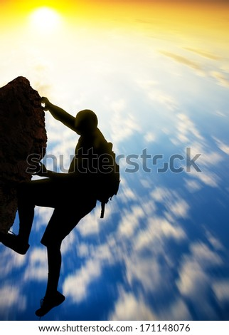 Rock climber at sunset background. Sport and active life #171148076