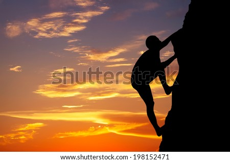 Rock climber at sunset background. Sport and active life