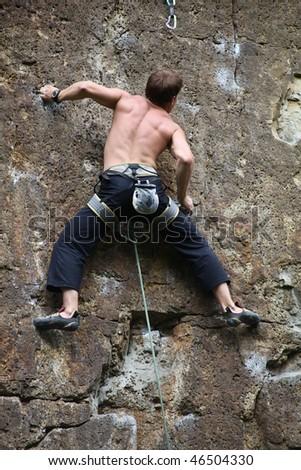 Rock climber climbing at the rock