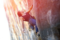rock climber climbs on a rocky wall