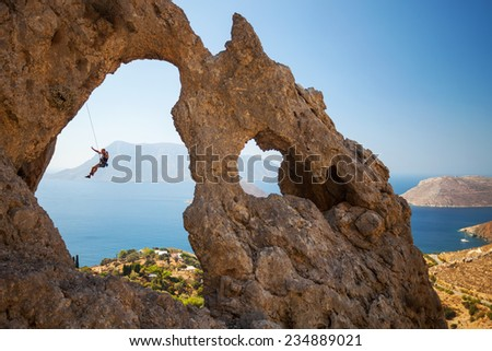 Rock climber falling of a cliff while lead climbing. Kalymnos Island, Greece   #234889021