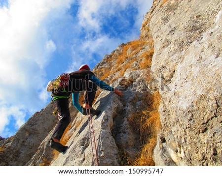Rock climber in autumn, Bulgaria