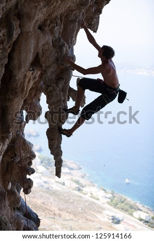 Rock climber on a cliff, Kalymnos Island, Greece