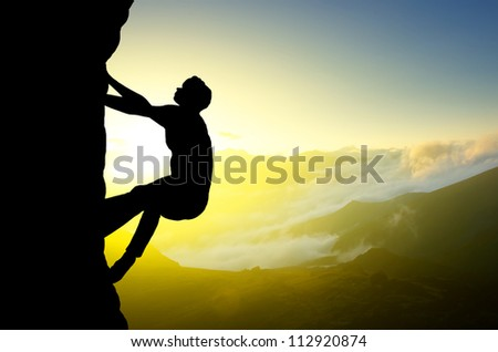 Rock climber on background of sundown. Sport and active life