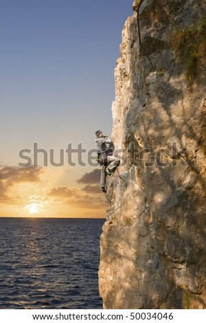 Rock climber on the water
