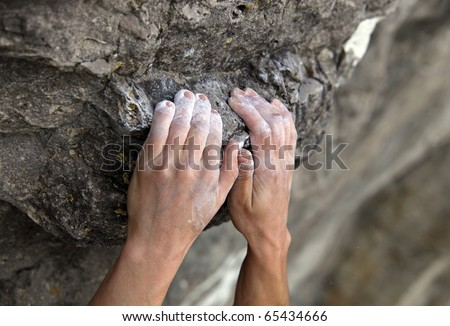 Rock climber's hands on handhold