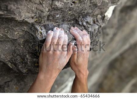Rock climber\'s hands on handhold