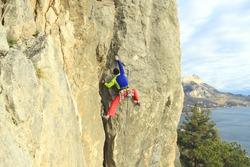 Rock climber to climb the wall.