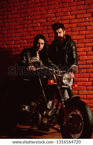 rock couple. sexy rock couple with motorcycle. rock couple travel on motorbike. rock couple in leather jacket