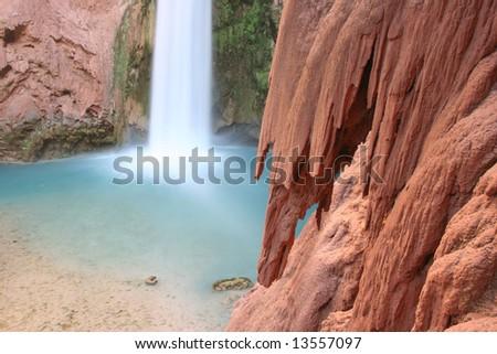 Rock details from famous natural landmark Mooney Falls, located on the Havasupai Indian Reserve. Arizona. USA