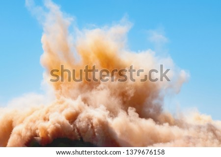Rock dust clouds after the blast on the mining site  #1379676158