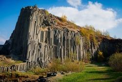 Rock formation natural monument Basalt organ. Polygonal structures of basalt columnar separation in Panska skala near Kamenicky Senov, northern Bohemia, Czech Republic. October 21, 2018