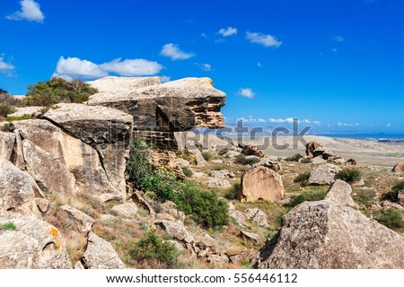 Rock formations, caves and ancient petroglyphs at Gobustan National Park, Azerbaijan.
