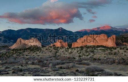 Rock formations in front of Pikes Peak at dawn at the Garden of the Gods in Colorado Springs, Colorado