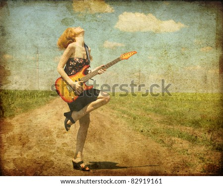 Rock girl with guitar at countryside. Photo in old color image style.