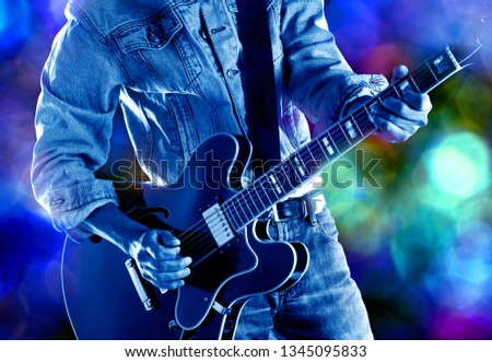 rock guitarist playing electric guitag live on stage