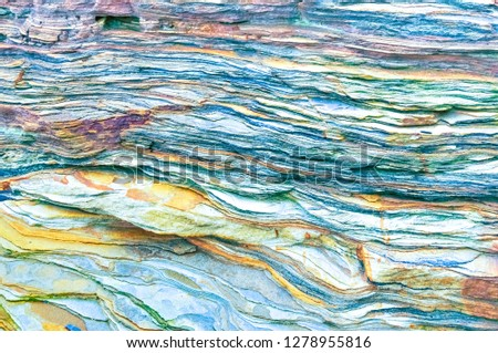 Rock layers - a colorful formations of rocks stacked over the hundreds of years. Interesting background with fascinating texture #1278955816