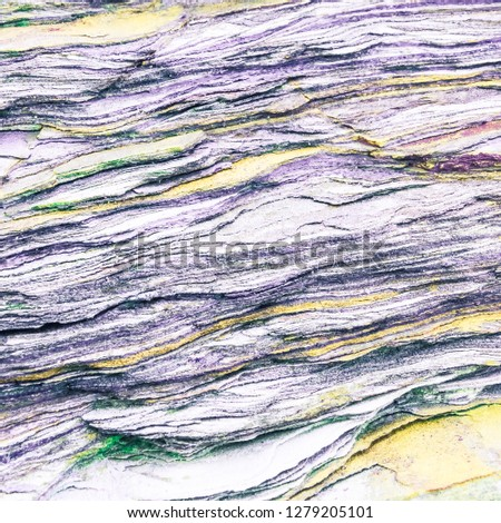 Rock layers - a colorful formations of rocks stacked over the hundreds of years. Interesting background with fascinating texture #1279205101