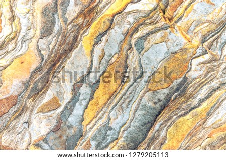 Rock layers - a colorful formations of rocks stacked over the hundreds of years. Interesting background with fascinating texture #1279205113