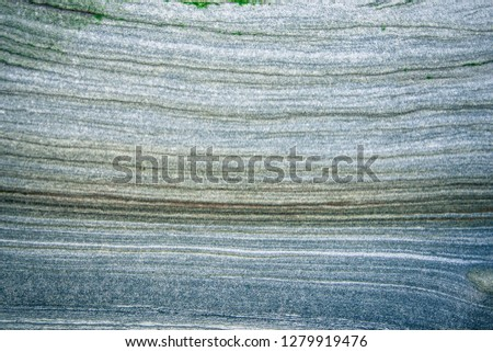 Rock layers - a colorful formations of rocks stacked over the hundreds of years. Interesting background with fascinating texture #1279919476