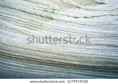 Rock layers - a colorful formations of rocks stacked over the hundreds of years. Interesting background with fascinating texture #1279919500