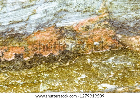 Rock layers - a colorful formations of rocks stacked over the hundreds of years. Interesting background with fascinating texture #1279919509