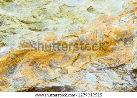 Rock layers - a colorful formations of rocks stacked over the hundreds of years. Interesting background with fascinating texture #1279919515