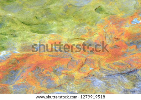 Rock layers - a colorful formations of rocks stacked over the hundreds of years. Interesting background with fascinating texture #1279919518