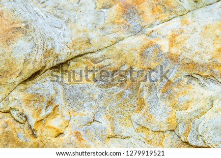 Rock layers - a colorful formations of rocks stacked over the hundreds of years. Interesting background with fascinating texture #1279919521