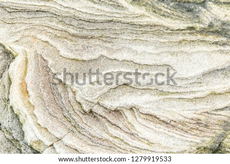 Rock layers - a colorful formations of rocks stacked over the hundreds of years. Interesting background with fascinating texture #1279919533