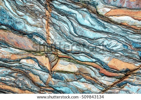 Rock layers - a colorful formations of rocks stacked over the hundreds of years. Interesting background with fascinating texture.