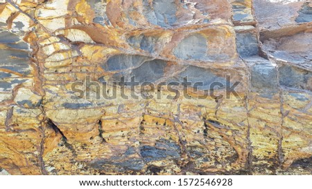 Rock layers,background and texture of mountain #1572546928