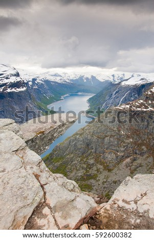 Rock lookout Trolltunga in Skjeggedal mountains - lake Ringedalsvatnet - Norway