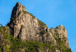 Rock mountain cliff and blue sky