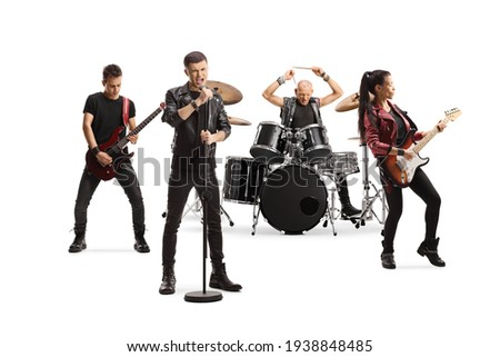 Rock music band performing with female guitarist, drummer and a male singer isolated on white background Photo stock ©